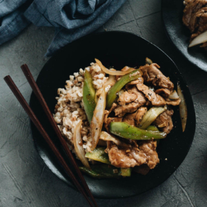 Pork Stir Fry with Pepper served on one plate with rice
