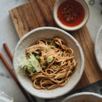 Chinese chicken noodle salad - a perfect summer dish: the noodles and shredded chicken are tossed in a nutty, savory peanut butter based sauce. It's super easy to prepare and addictively good! {gluten-free adaptable} #asian #healthy #sesame #simple