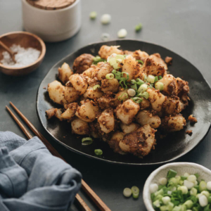 Chinese Sauteed potato - Crispy, tender, buttery potatoes cooked with a bold Asian spice mix. It's an easy dish to cook and great to serve for breakfast or as a side. #vegetarian #vegan #glutenfree