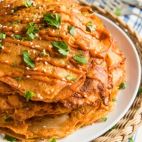 These cheesy kimchi pancakes require minimal prep and only 20 minutes to cook. They also provide a clever way of using up leftovers. Isn't it a great lunch solution?   omnivorescookbook.com