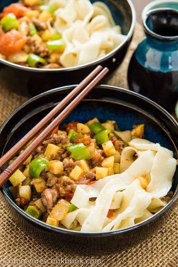 The tender ground lamb meat is cooked with potato, tomato, onion, and pepper to create a simple, colorful, and delectable noodle sauce - Uyghur-Style Noodles with Lamb Sauce (Laghman, 新疆拌面) | omnivorescookbook.com