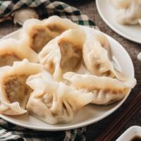 Homemade lamb dumplings with dipping sauce