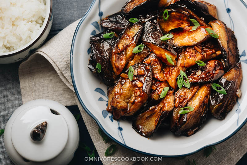 Chinese eggplant with garlic sauce served in plate