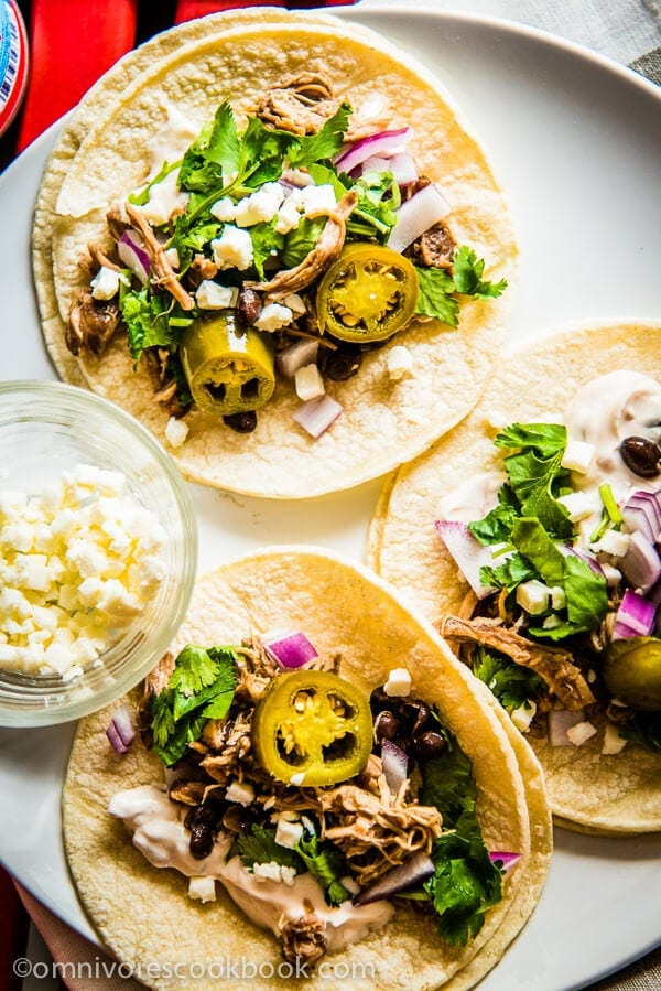 Pulled Chicken Tacos - Adding some chicken thigh into braised pork, you can create this rich, moist and tender pulled chicken effortless! | omnivorescookbook.com