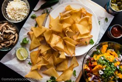 Wonton Nachos with Pulled Chicken and Mango Salsa - A fun way of using wonton wrappers to create a colorful and healthy festival feast. | omnivorescookbook.com