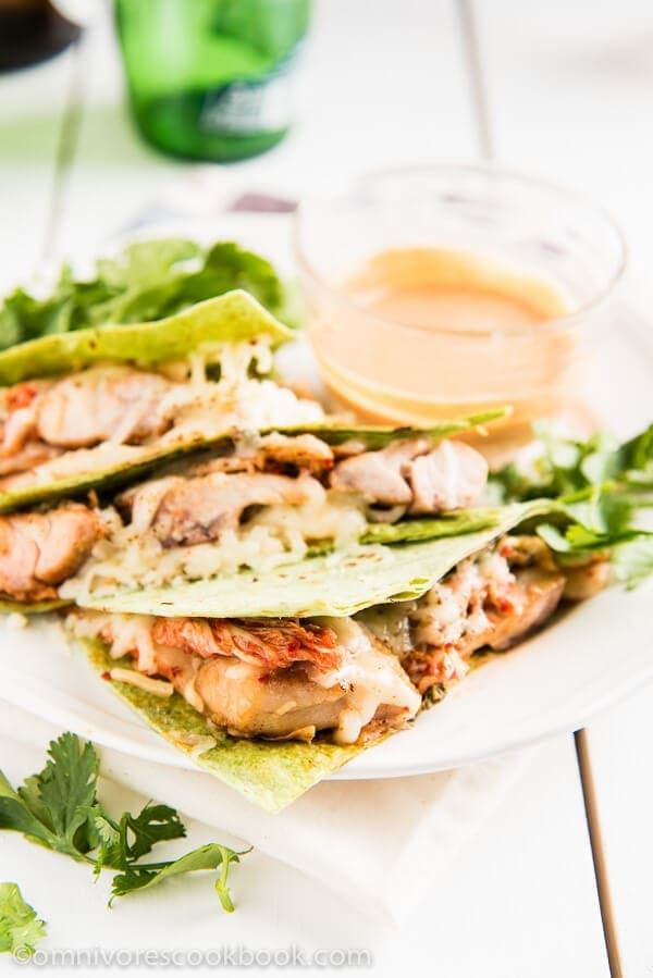 Kimchi chicken quesadillas - Learn how to use minimal seasoning to create the best flavor. Tender chicken + pungent kimchi + melted cheese = perfection!   omnivorescookbook.com