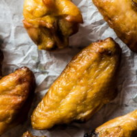 Oven Fried Chicken Wings with Korean BBQ sauce - create the most crispy wings with minimal effort and oil! | omnivorescookbook.com