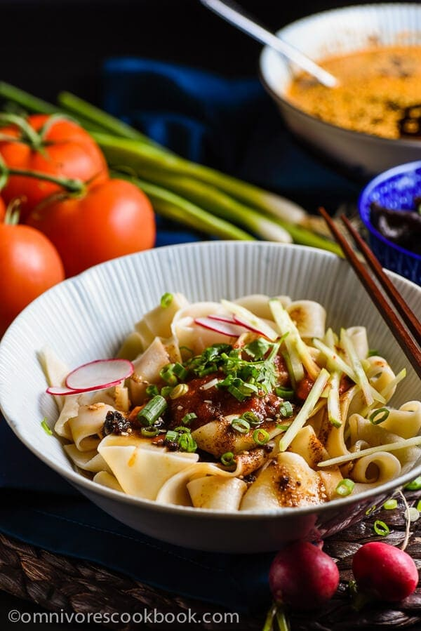 Biang Biang Noodles - With a spoonful of savory seasoned soy sauce and fresh, nutty hot sauce, the thick and meaty handmade noodles will bring you to foodgasm! | omnivorescookbook.com