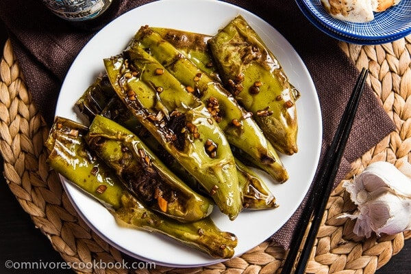Szechuan Pan Fried Peppers (Tiger Skin Peppers, 虎皮尖椒) - These peppers are pan fried until blistered and tender, then cooked in a sour, savory sauce. A great vegan dish that is hot, flavorful, and appetizing! | omnivorescookbook.com
