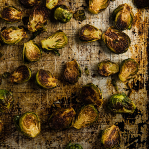 Roasted Brussels Sprouts with Plum Sauce - Learn how to use dried plums and curry powder to make an extra rich plum sauce.   omnivorescookbook.com