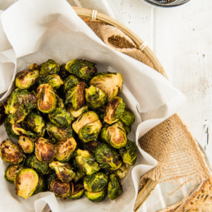Roasted Brussels Sprouts with Plum Sauce - Learn how to use dried plums and curry powder to make an extra rich plum sauce. | omnivorescookbook.com