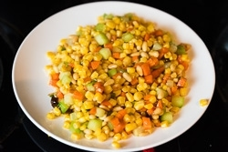 Stir Fried Corn with Pine Nuts Cooking Process | omnivorescookbook.com