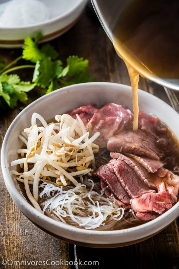 Easy Vietnamese pho noodle soup - Want to get a hearty bowl of Vietnamese pho noodle soup on the table within 30 minutes? Look no further!   omnivorescookbook.com