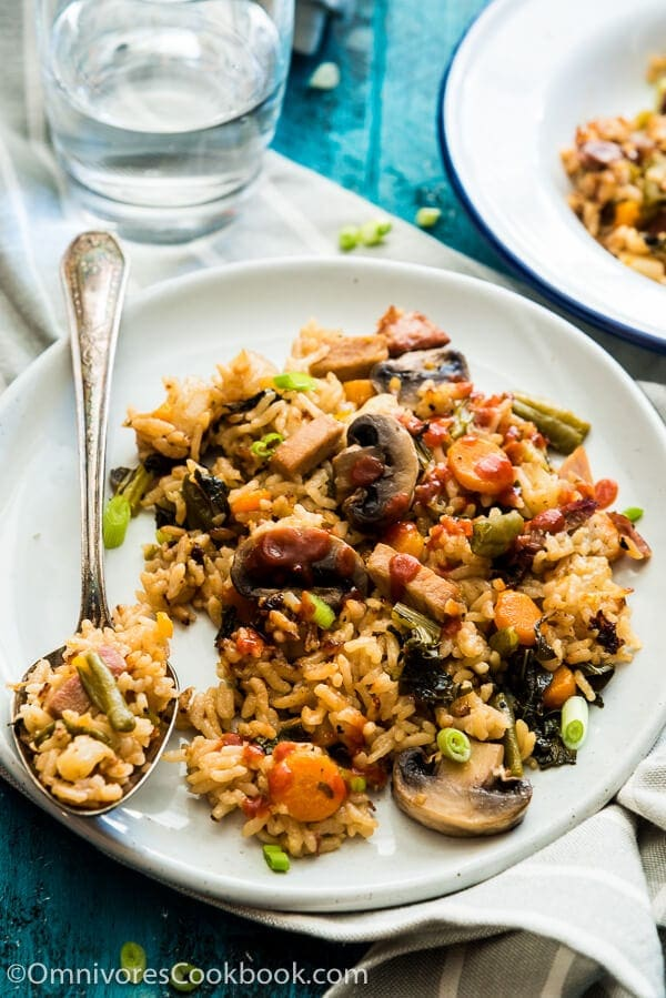 Instant Pot Rice Pilaf - A jambalaya-style rice that is loaded with veggies. You only need 10 minutes to prep, then you can sit back and relax. Your one-dish dinner will be ready in 15 minutes.