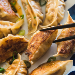 Carrot Dumplings - An elegant vegetarian dumpling that uses carrots, bamboo shoots, mushrooms, and eggs to create a fresh, moist, and rich filling.