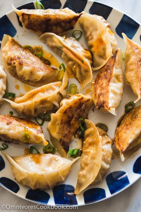 Carrot Dumplings - An elegant vegetarian dumpling that uses carrots, bamboo shoots, mushrooms, and eggs to create a fresh, moist, and rich filling.