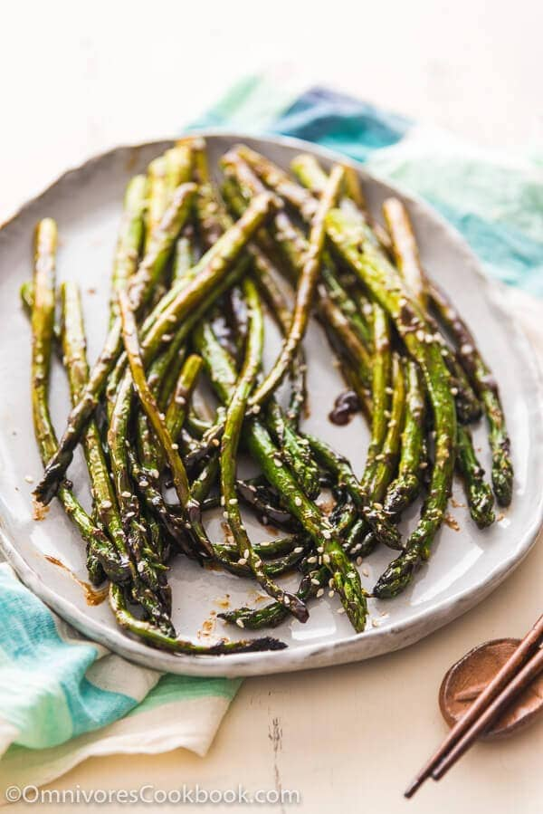 Hoisin Roasted Asparagus - Requires only two ingredients; the asparagus are perfectly charred, flavorful, and tender. You can either grill them or bake them in the oven.