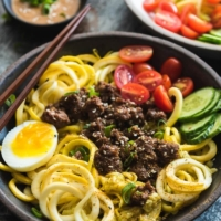 Sesame Beef Squash Noodle Bowl - A paleo-friendly one-bowl feast that is perfect for your weekday dinner. It is quick to cook, can be prepared ahead of time, and is balanced in nutrition.