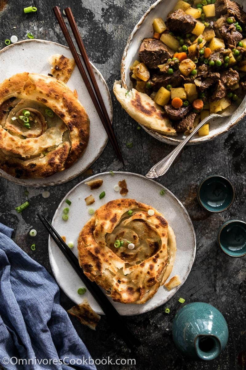 Learn how to cook the real-deal scallion pancakes that are light and crispy. Video and step-by-step pictures included.