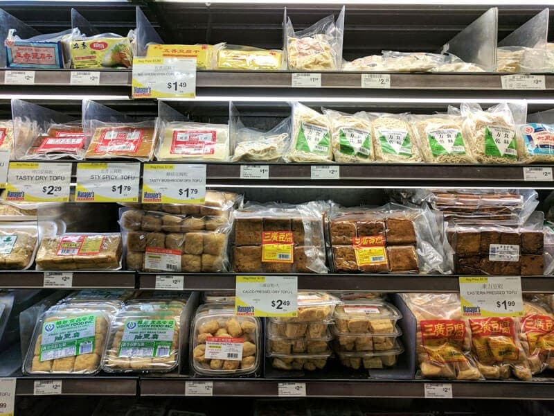 Various tofu products in grocery store
