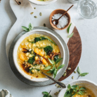Tinutuan (Indonesian pumpkin porridge) is fragrant, hearty, and loaded with nutrition. It's the perfect side dish to warm your body and heart as the weather gets cooler. {Gluten-Free, Vegetarian}