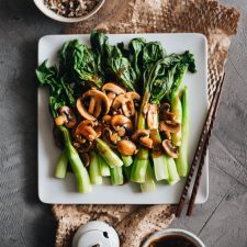 The Chinese broccoli is steamed and served with stir fried mushrooms and a scrumptious brown sauce. It's a quick and delicious way to put plenty of veggies on your dinner table. {Vegetarian, Gluten-Free Adaptable}
