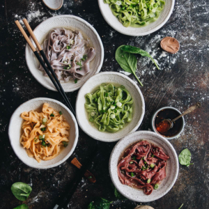 Rainbow Longevity Noodles for Chinese New Year - Made with all-natural vegetarian ingredients and served in a simple, rich broth, they guarantee your dinner party will be a blast.