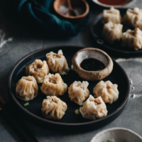 Learn how to make the famous dim sum classic, shumai - steamed dumplings filled with juicy pork and shrimp. It's a perfect party food to make in advance and serve later.