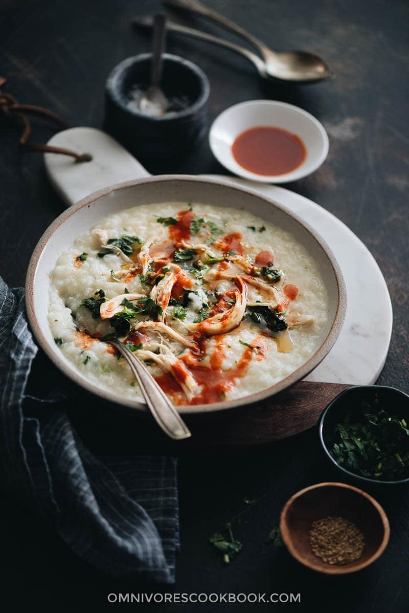 Instant Pot congee with chicken and spinach served in a bowl
