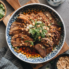 This Fu Qi Fei Pian (Sichuan Sliced Beef in Chili Sauce) recipe gives you the real-deal Sichuan experience. The tender beef slices are served in a rich, spicy hot sauce and topped with peanut flakes and cilantro. #glutenfree #beef #instantpot #chinese #recipes