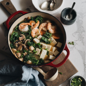 A big pot of shrimp soup with tofu and kale