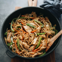 Chicken Lo Mein with peppers, onion, and bamboo shoots close up