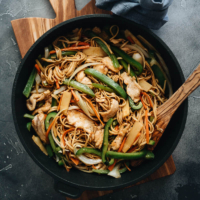 Easy Chicken Lo Mein (Authentic Taste Without A Wok) - Homemade tender chicken, crisp peppers and bamboo shoots, and thick noodles all tossed in a rich sauce that is fragrant, savory and slightly sweet. Make your favorite Chinese takeout without a wok - it is healthy and tastes great. #vegetables #chicken #takeout #glutenfree #noodles #recipe