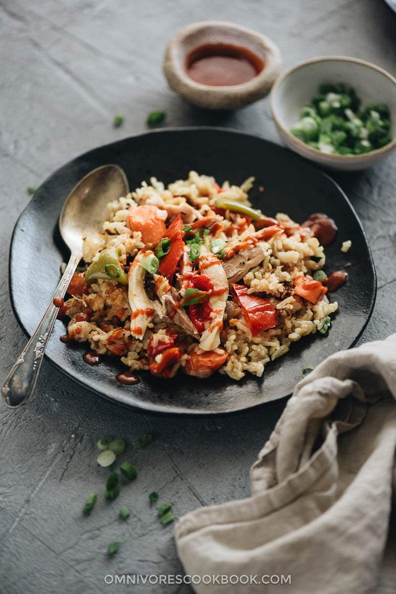 Asian Instant Pot chicken and rice served with Sriracha sauce
