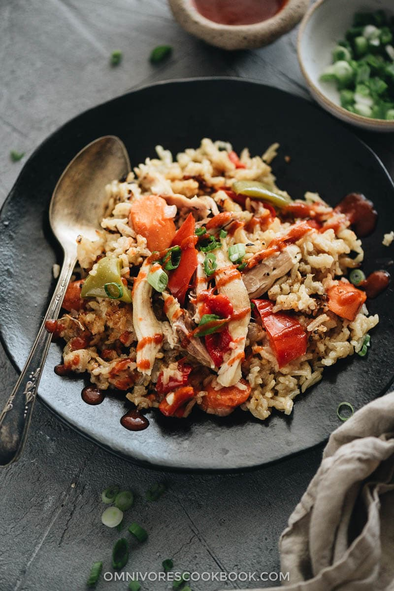 Instant Pot chicken and rice served with Sriracha sauce