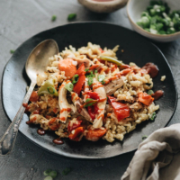 Instant Pot Chicken and Rice (A Pressure Cooker Recipe) - An easy one-pot meal prepared with Asian-style seasonings. The tender rice, juicy chicken, and colorful peppers are cooked with a gingery, garlicky flavor. So irresistible! {Gluten free adaptable} #recipes #asian #onepot #healthy