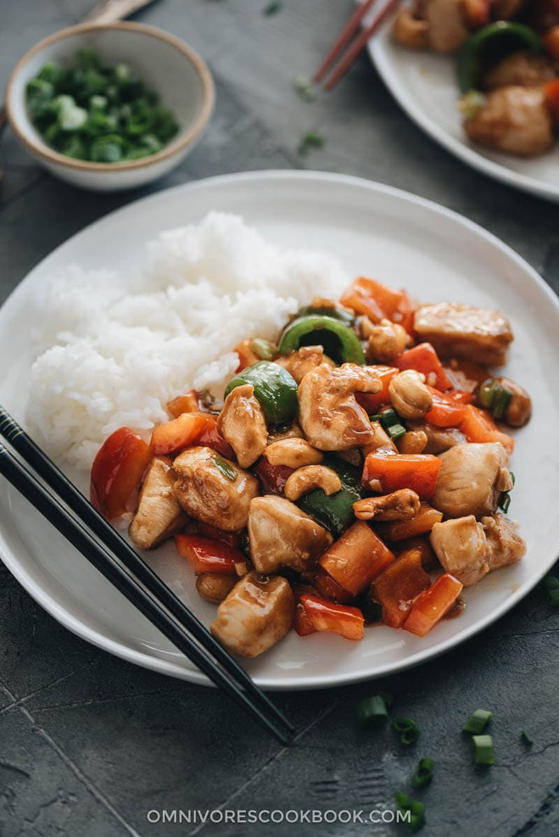 Restaurant style cashew chicken served with rice close up