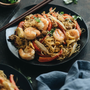Easy Singapore noodles loaded with shrimp, pork, egg, onion, and pepper.