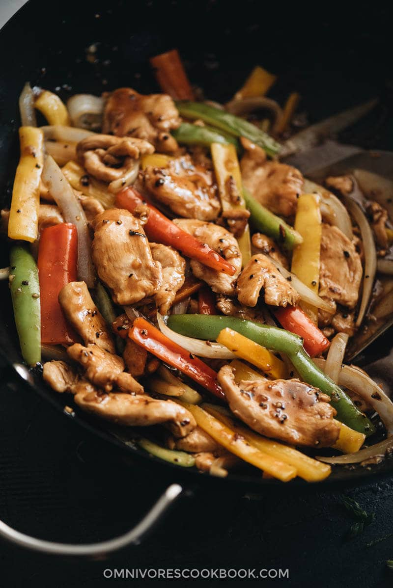 Chinese restaurant style black pepper chicken in a wok close up