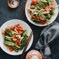 Stir fried vegetables including onion, broccoli, carrot, mushroom, bamboo shoot, and snow peas