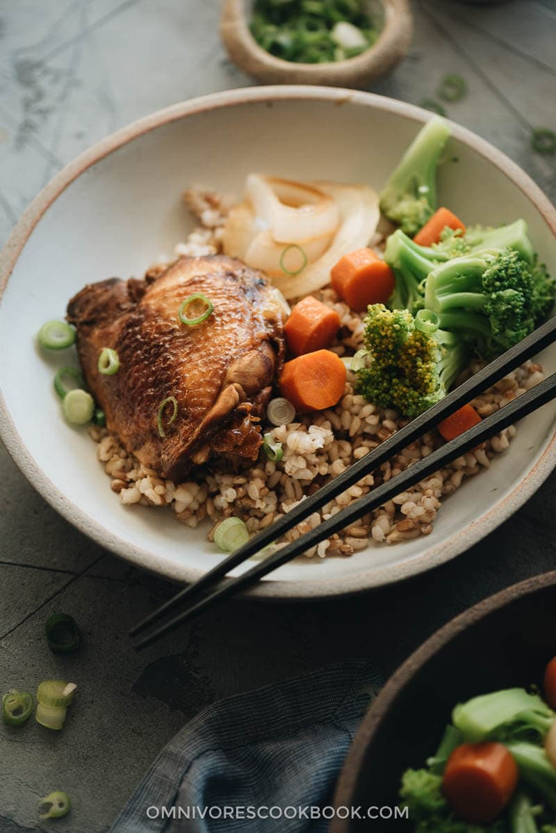 Filipino chicken adobo with onion and carrot served over rice and broccoli
