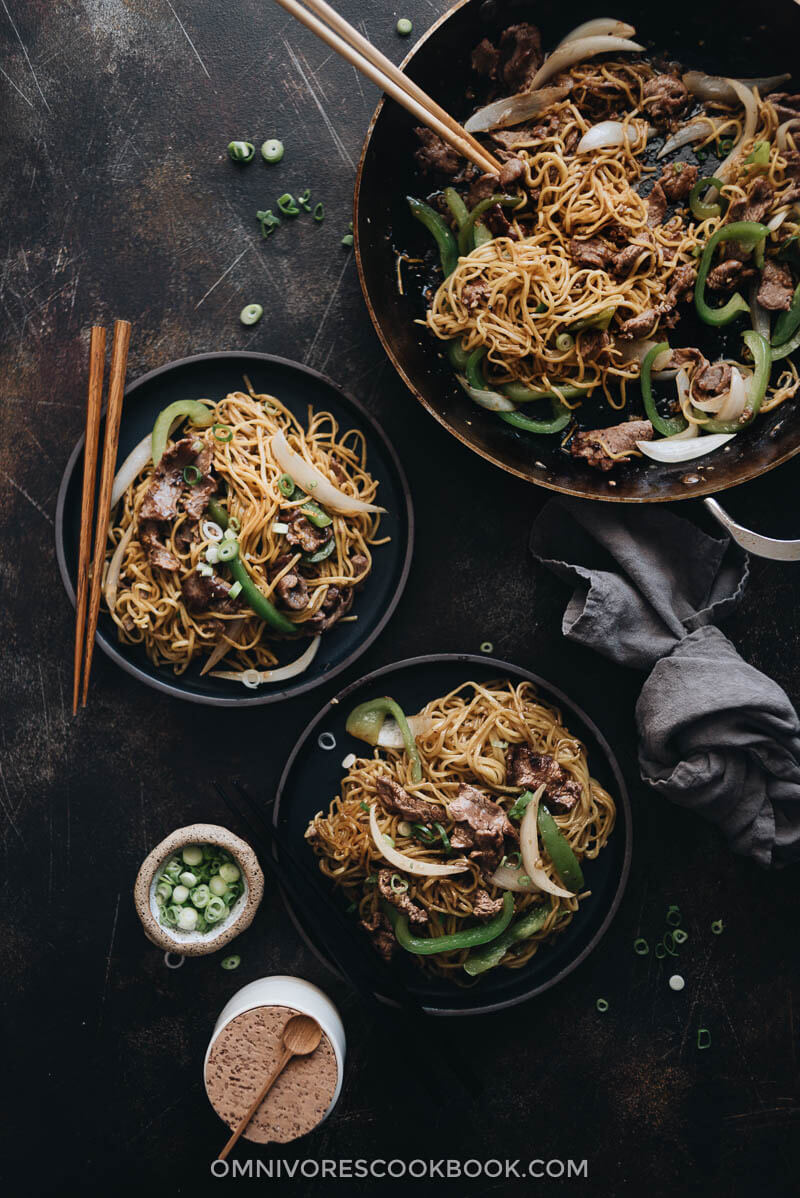 Homemade beef chow mein in skillet and served in plates