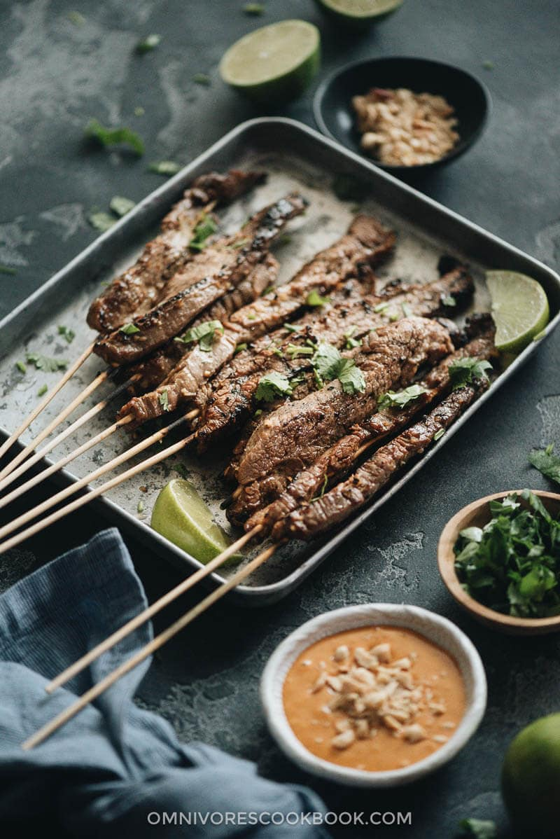 Grilled beef satay served on a tray