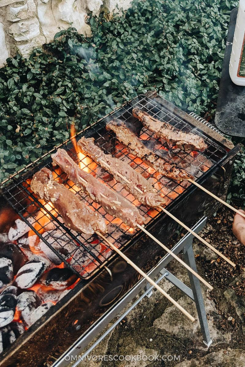 Grilling beef satay on a Chinese grill
