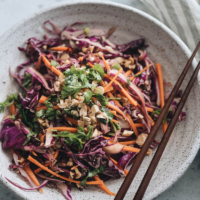 The Best Chinese Coleslaw - This healthy twist on Chinese coleslaw will be your new favorite side dish. The tangy yet sweet dressing mixed with the crispy texture will make it disappear fast at any gathering. #easy #recipes #soysauce #glutenfree