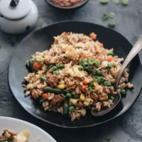 10-Minute Pork Fried Rice - An easy and delicious way to get dinner on the table fast, this authentic pork fried rice with eggs hits all the right notes with great flavors and textures and tastes better than takeout. #chinese #veggies #recipes #glutenfree