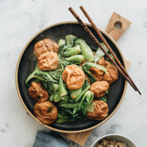 Stir Fried Baby Bok Choy with Gluten Balls - Very easy to make and bursting with flavor, it's a great choice if you're trying to find an interesting way to spice up your vegetarian meal and add a dose of plant-based protein. #chinese #recipes #vegan #stirfry