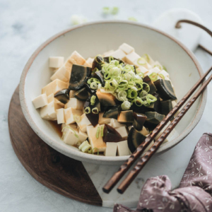 Century egg with tofu salad garnished with green onions