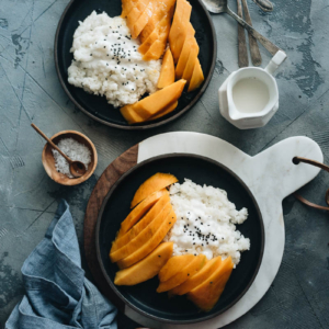Traditional Thai mango sticky rice served in plates