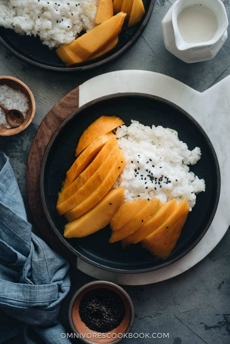 Traditional Thai mango sticky rice with black sesame seeds topping